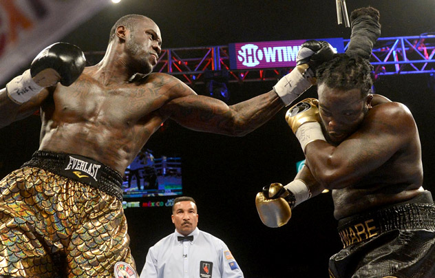 Deontay Wilder (L) on his way to winning the WBC heavyweight title against Bermane Stiverne. Photo by Naoki Fukuda.