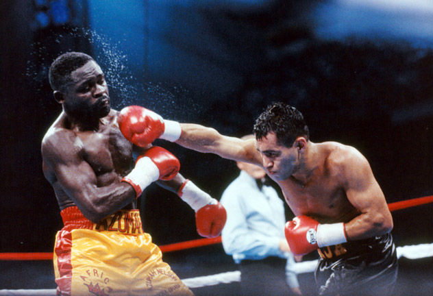 Jesse James Leija (R) during the first of four fights against Azumah Nelson, on Sept. 10, 1993. The bout ended in a draw. Photo: THE RING.