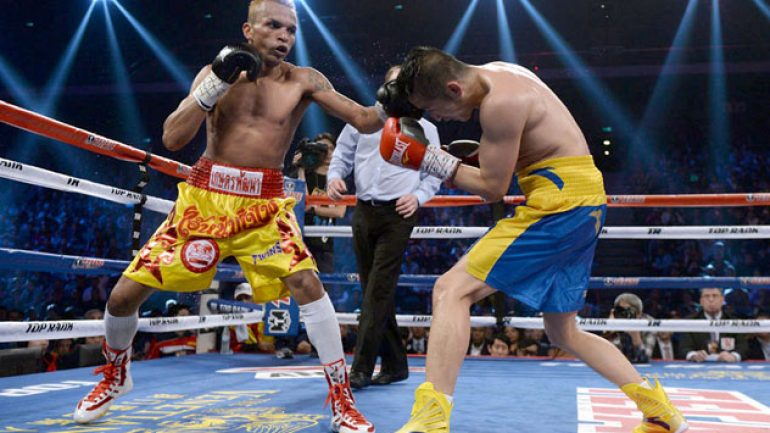Amnat Ruenroeng retains title with UD over Zou Shiming