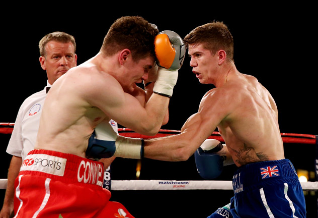 Luke Campbell (R) slams Lee Connelly with a body shot on Nov. 2, 2013, in Campbell's hometown of Hull, England. Photo by Scott Heavey/Getty Images.