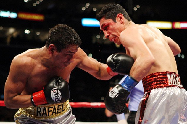 Israel Vazquez (R) battling his nemesis, Rafael Marquez, during their fourth and final fight in May 2010. Photo by Tom Casino/Showtime.
