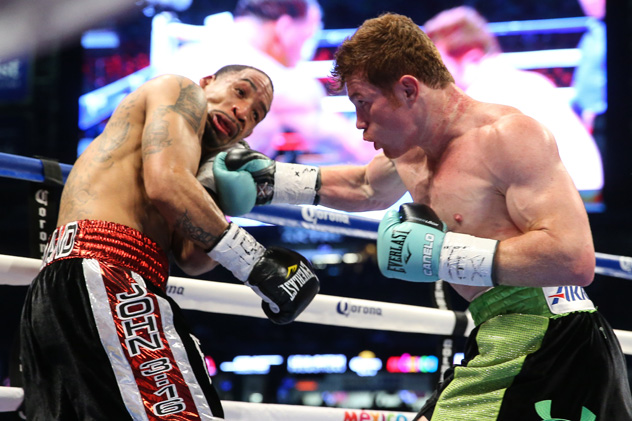 Canelo Alvarez punishes James Kirkland. Photo by Ed Mulholland / Getty Images