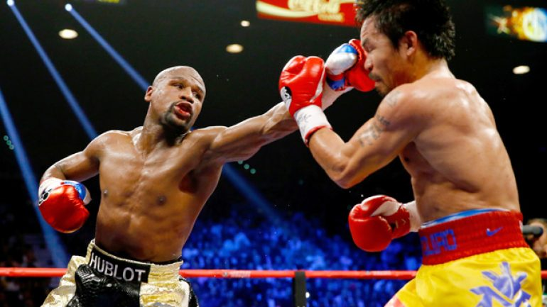 Floyd Mayweather Jr. defeats Manny Pacquiao by a unanimous decision