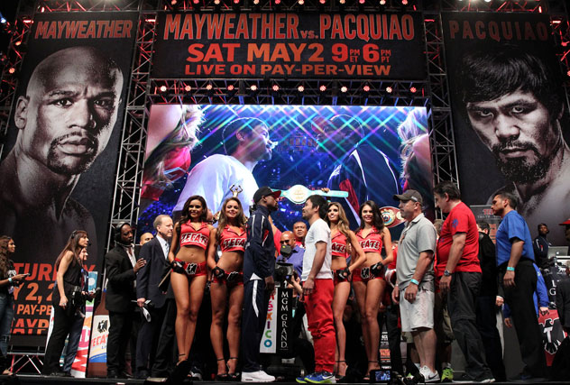 Manny Pacquiao and Floyd Mayweather Jr. weigh-in for their May fight. Photo: Chris Farina