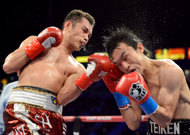 Nonito Donaire (L) lands an uppercut on Toshiaki Nishioka en route to a ninth-round TKO in October 2012. Photo by Harry How/Getty Images.