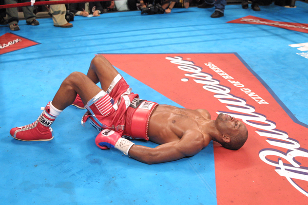 Bernard Hopkins lays on the canvas in the aftermath of his victory over Felix Trinidad on Sept. 29, 2001. Photo by Al Bello/Getty Images.
