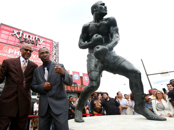 Marvis Frazier (right) and Rev. Blane Newberry from Enon Tabernacle Baptist Church bless the bronze statue dedicated to late world heavyweight champion Joe Frazier after it was unveiled at XFINITY Live! Saturday Sept. 12, 2015. Photo credit: David Swanson/Staff Photographer/Philly.com