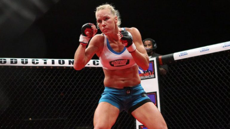 Can former boxing champ Holly Holm upset Ronda Rousey?