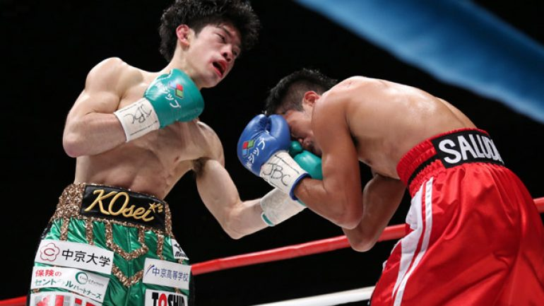 Tanaka weathers knockdown, stops Saludar in six to retain title
