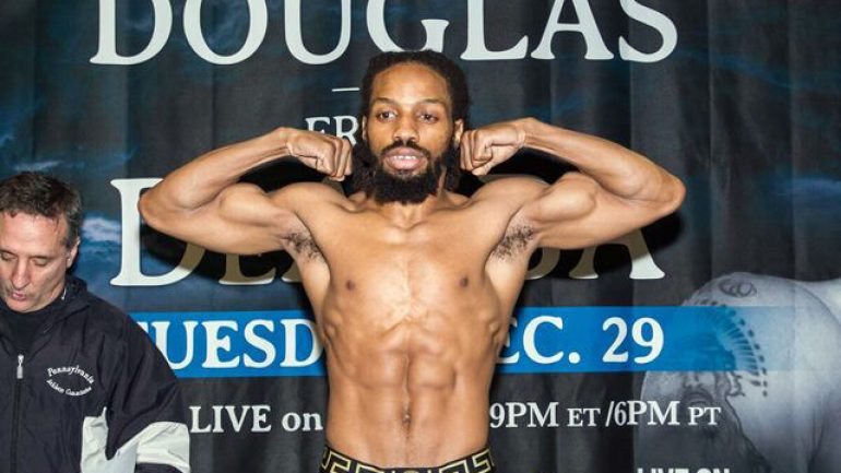 Omar Douglas remains undefeated with spirited majority decision