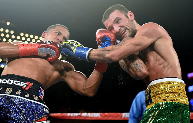 Felix Verdejo (L) threads an uppercut through the defense of William Silva in February 2016. Photo: Naoki Fukuda