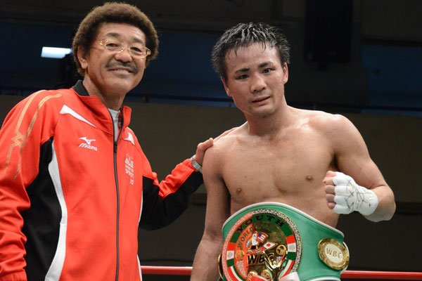 Undefeated flyweight Daigo Higa (right) with promoter/manager Yoko Gushiken. Photo courtesy of the WBC