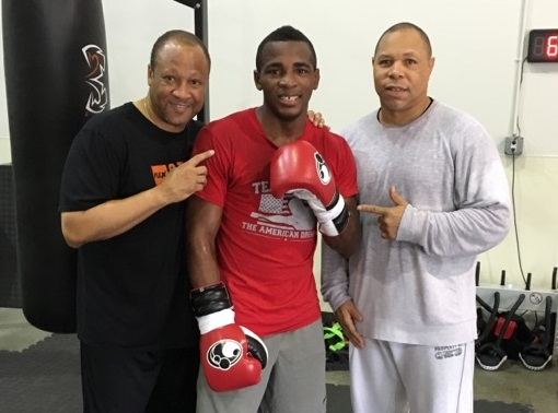 Trainer Ronnie Shields (L) with junior middleweight titleholder Erislandy Lara. Photo by Edward Jackson.
