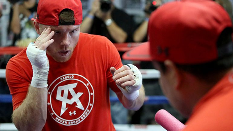 Canelo Alvarez pounds heavy bags in preparation for Liam Smith