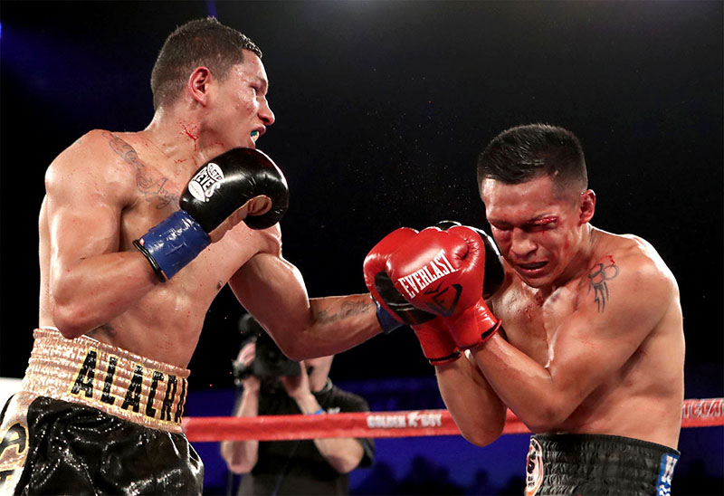 Miguel Berchelt (left) lands a left hook to the bloody face of Francisco Vargas en route to stopping the previously unbeaten WBC 130-pound titleholder on January 28, 2017, in Indio, California. Photo by Tom Hogan-Hoganphotos / Golden Boy Promotions