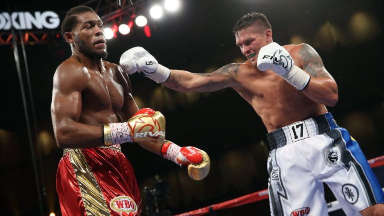 Oleksandr Usyk outpoints Michael Hunter to retain his title