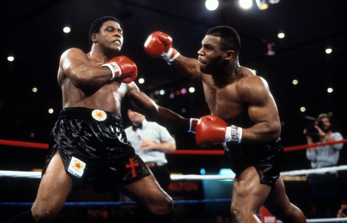 Mike Tyson (right) attacks Berbick. Photo by THE RING