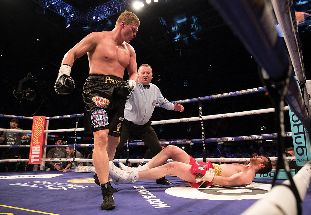Heavyweight contender Alexander Povetkin (standing) vs. David Price. Photo by Richard Heathcote/Getty Images