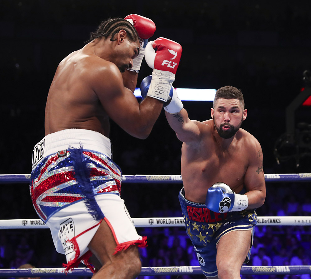 Tony Bellew (right) tags David Haye. Photo by Lawrence Lustig