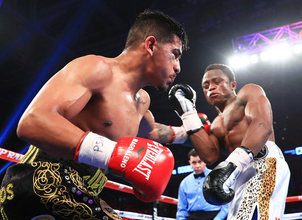 Isaac Dogboe (right) vs. Jessie Magdaleno. Photo by Mikey Williams/Top Rank