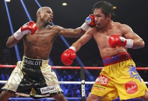 Floyd Mayweather Jr. (left) vs. Manny Pacquiao. Photo credit: Steve Marcus/Reuters