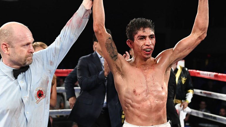 Rey Vargas gets off the canvas, retains title by decision over wild Franklin Manzanilla