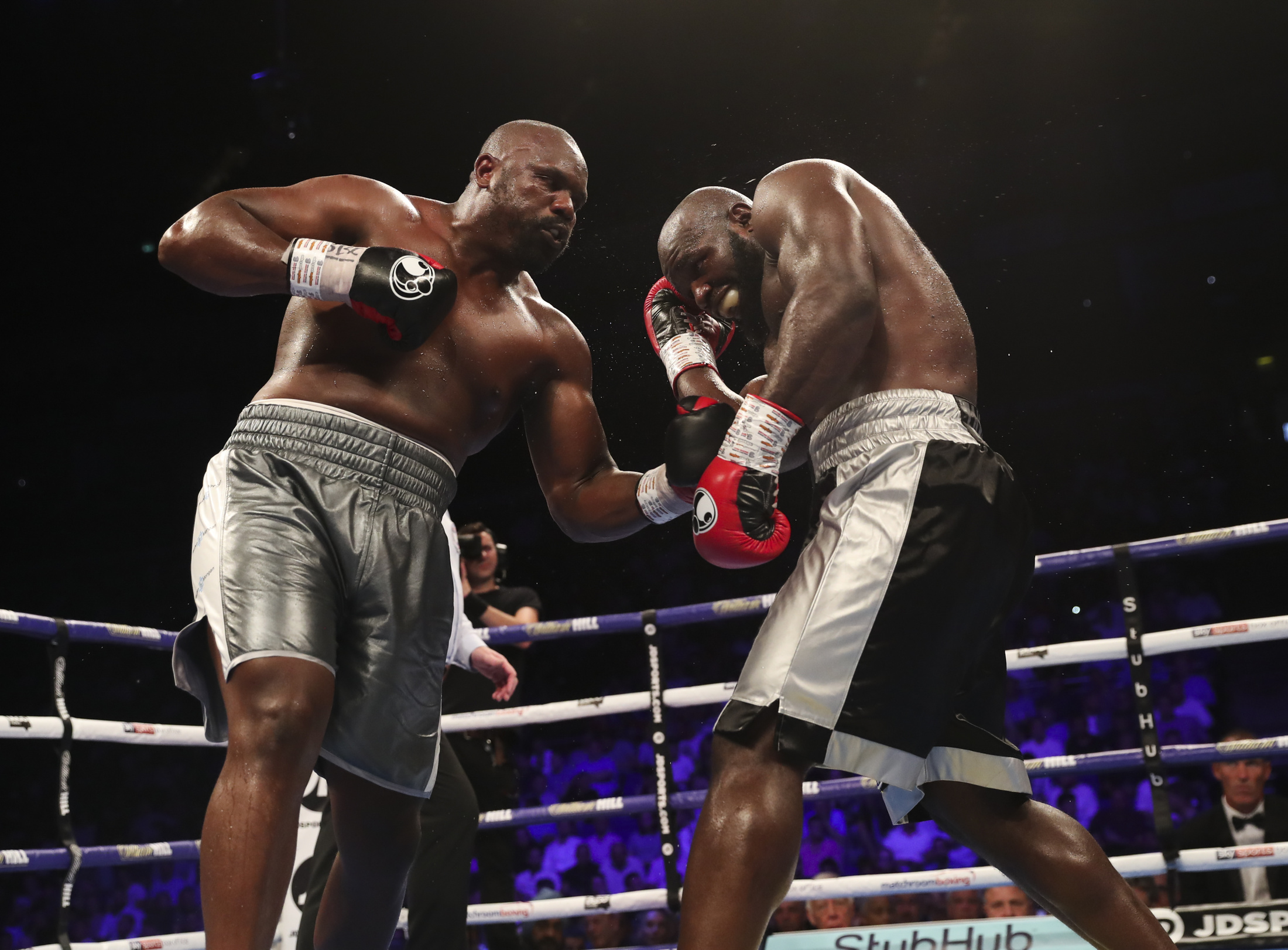 Heavyweight Dereck Chisora (left) attacks Carlos Takam. Photo by Lawrence Lustig