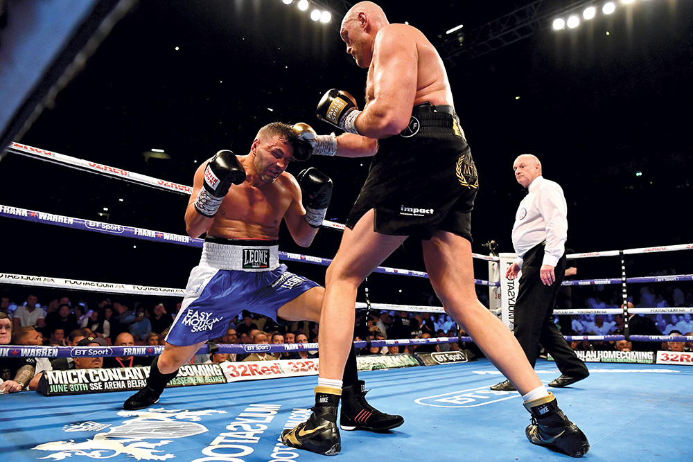 Sefer Seferi (left) couldn't get anywhere against Tyson Fury. (Photo by Justin Setterfield/Getty Images)
