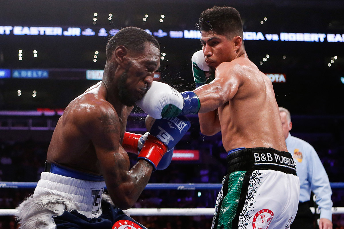 Mikey Garcia (right) was too much for fellow lightweight beltholder Robert Easter Jr. to handle, but what happens if he takes on welterweight destroyer Errol Spence Jr. next?