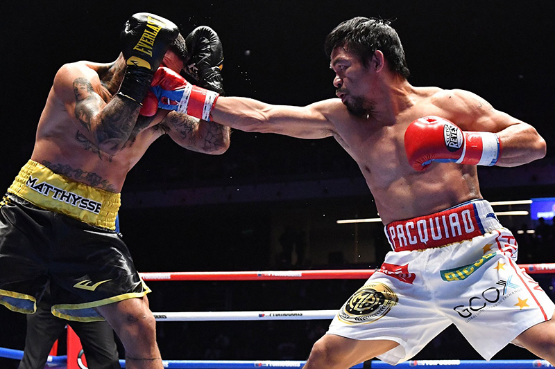 Welterweight Manny Pacquiao (right) jabs at Lucas Matthysse. Photo courtesy of Reuters and Golden Boy Promotions