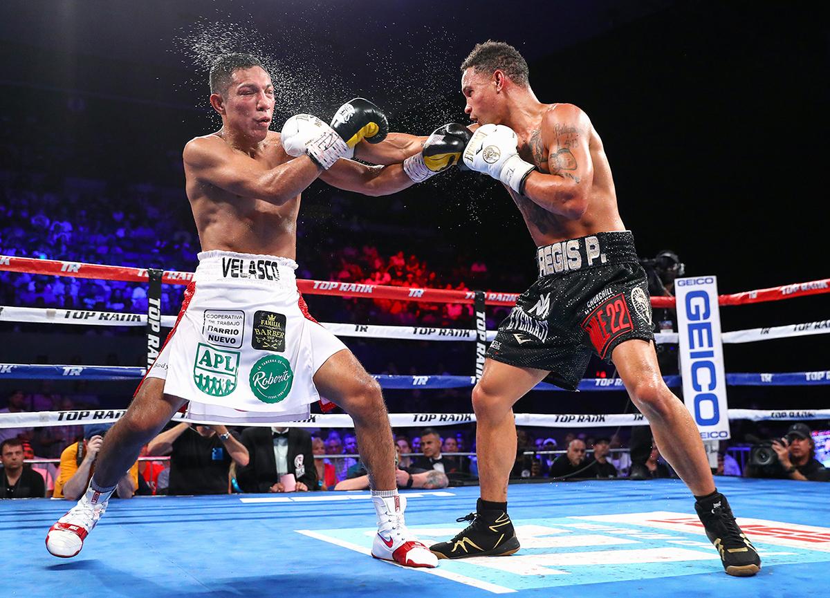 Junior welterweight Regis Prograis (right) vs. Juan Jose Velasco. Photo by Mikey Williams - Top Rank
