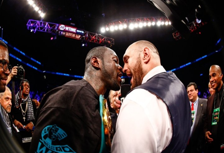 Tyson Fury (right) and Deontay Wilder.