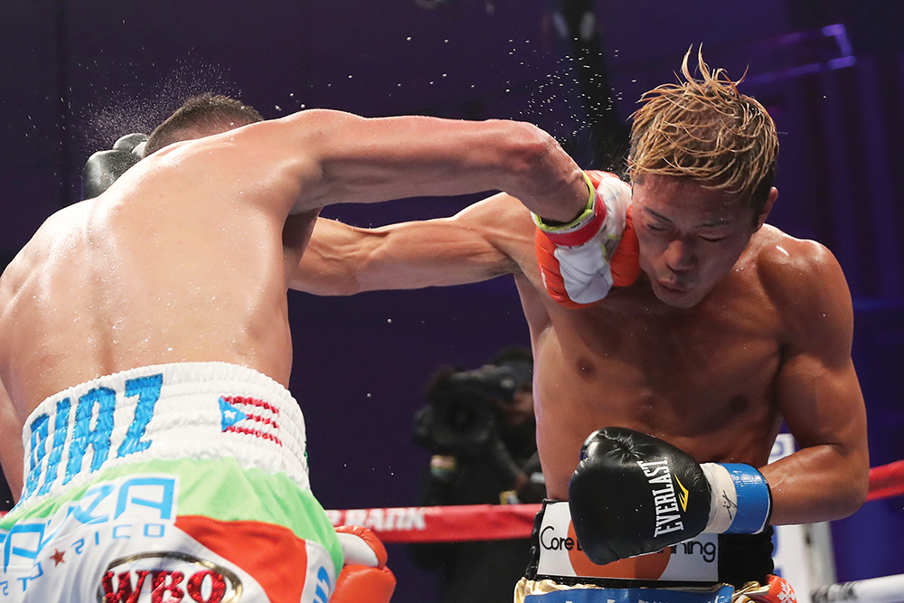 Masayuki Ito (right) and Christopher Diaz traded leather for 12 intense rounds, with the unheralded Japanese fighter earning a unanimous decision to claim the vacant WBO 130-pound title. Photo credit: Getty Images