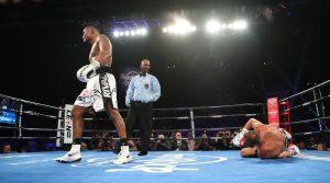 Eleider Alvarez (standing) vs. Sergey Kovalev. Photo courtesy of HBO Boxing