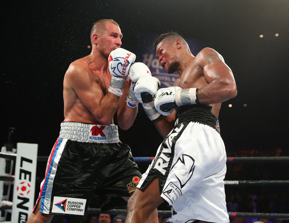 Sergey Kovalev (left) is nailed on the inside by Eleider Alvarez. Photo courtesy of HBO Boxing