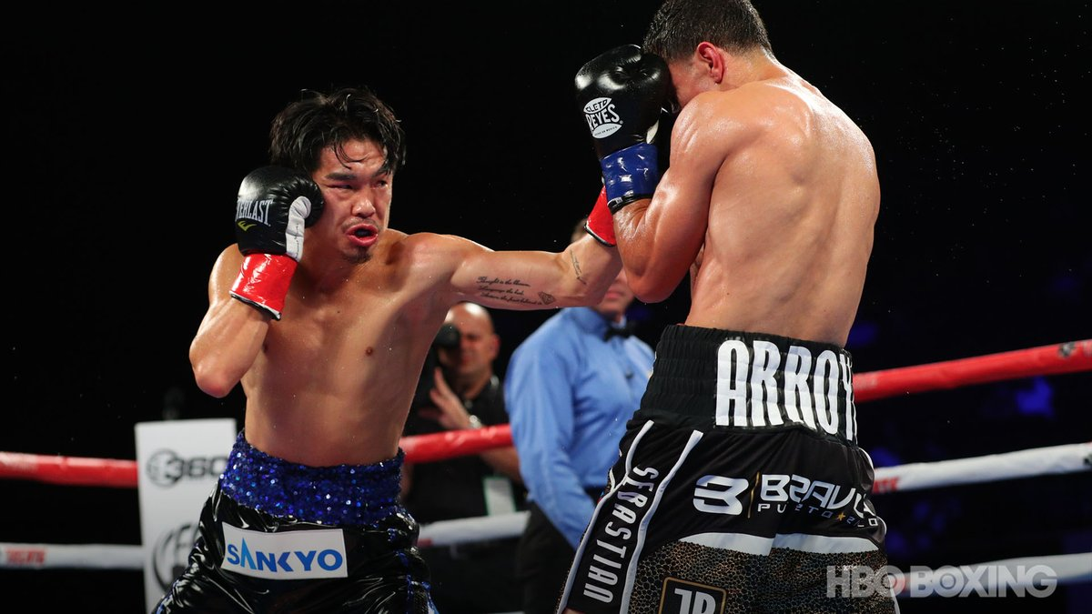 Three-division titlist Kazuto Ioka (left) connects with a left hook against McWilliams Arroyo. Photo / @HBOBoxing