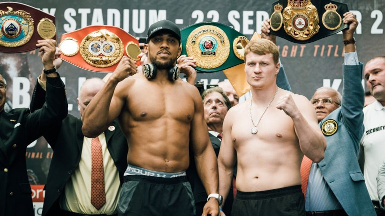 Anthony Joshua towers over Alexander Povetkin at heavyweight title weigh-in