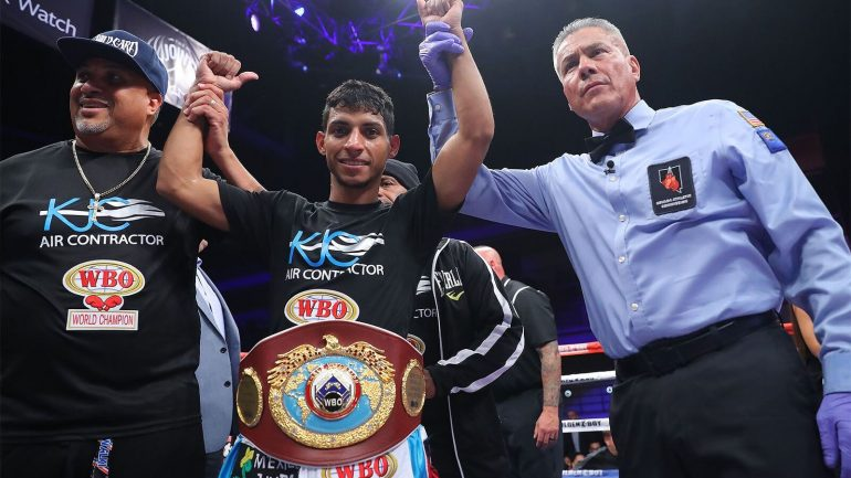 Angel Acosta to defend 108-pound title against Ganigan Lopez on March 30