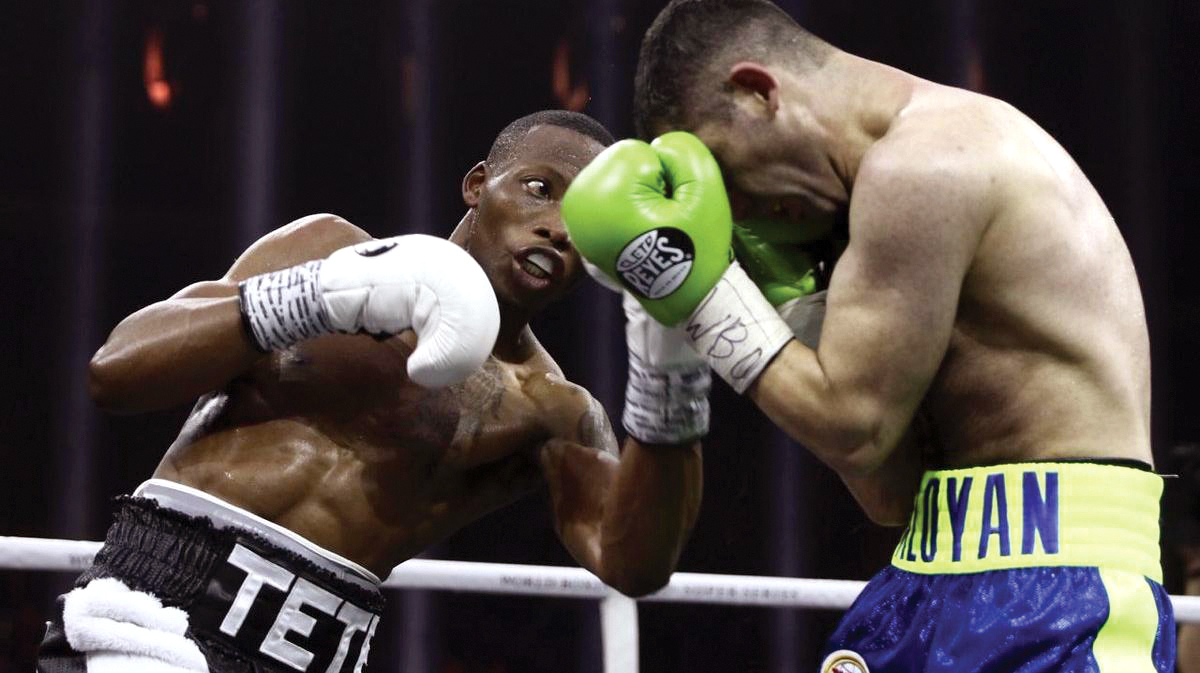 Zolani Tete (left) handled a tough challenge from Mikhail Aloyan to win by unanimous decision.