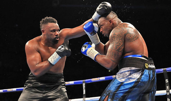 Dereck Chisora (left) and Dillian Whyte go to war in their first fight. Photo by Lawrence Lustig