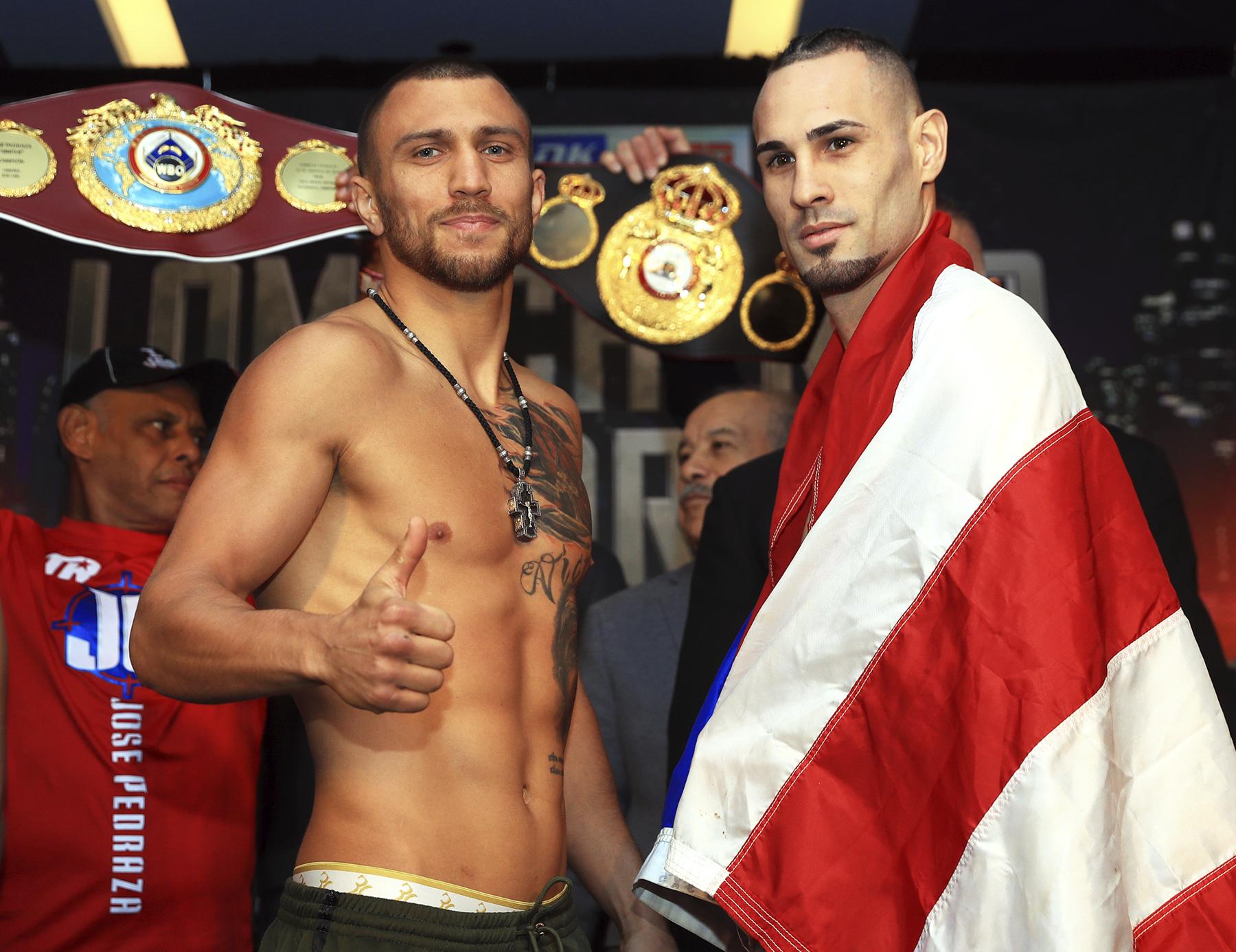 The Ring Magazine/WBA/WBO lightweight champion Vasiliy Lomachenko (left) and Jose Pedraza. Photo by Mikey Williams/Top Rank