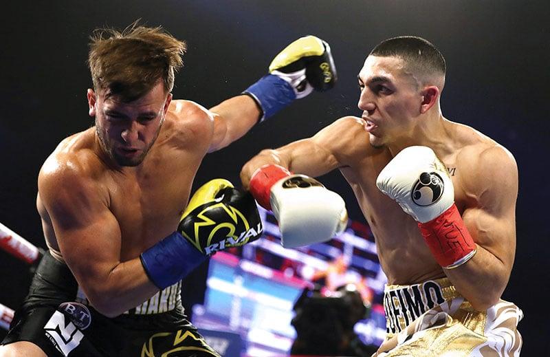 Lightweight Teofimo Lopez (right) vs. Mason Menard. Photo credit: Al Bello/Getty Images