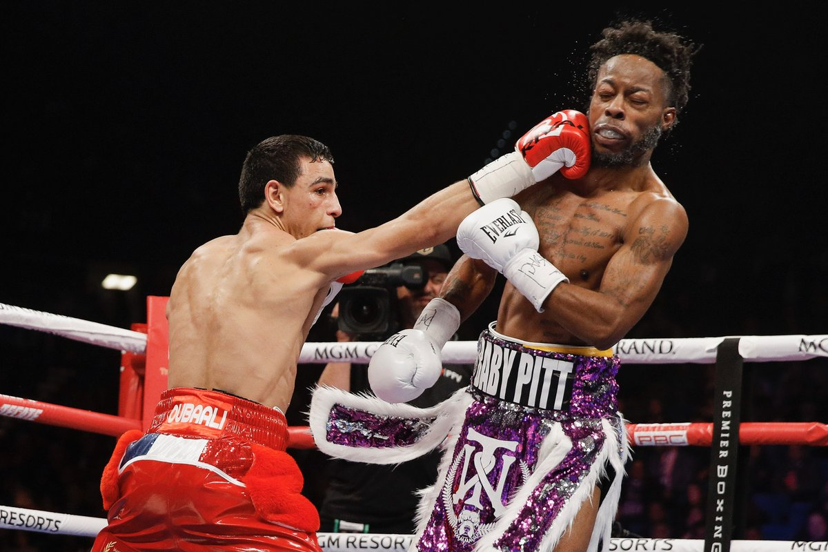 Bantamweight Nordine Oubaali (left) nails Rau'Shee Warren with a right hand. Photo credit: Showtime Boxing