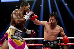 Pacquiao Broner action shot 300x200 - Manny Pacquiao outhustles Adrien Broner over 12 rounds in first U.S. fight in over two years