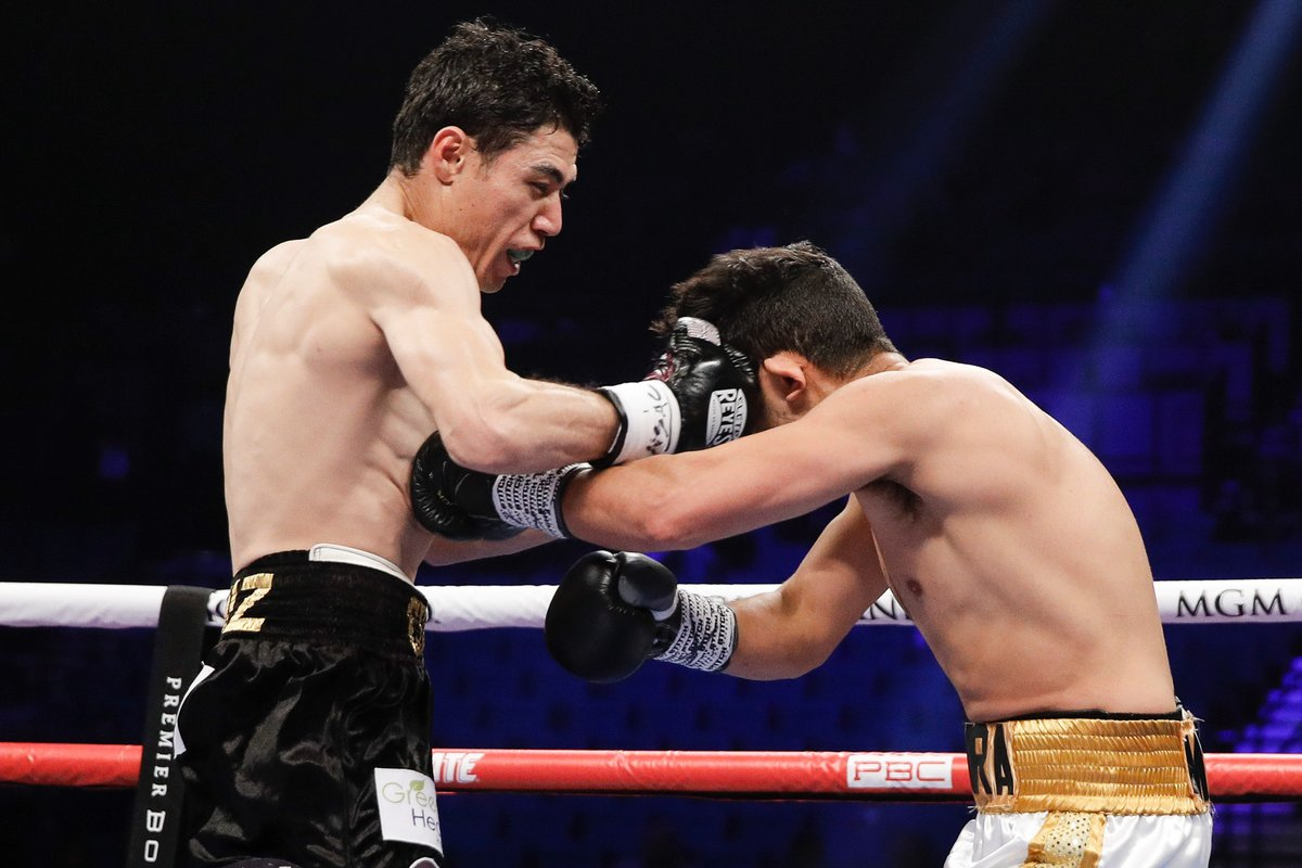 Featherweight contender Hugo Ruiz (left) catches Alberto Guevara with a right cross. Photo credit: Showtime Boxing