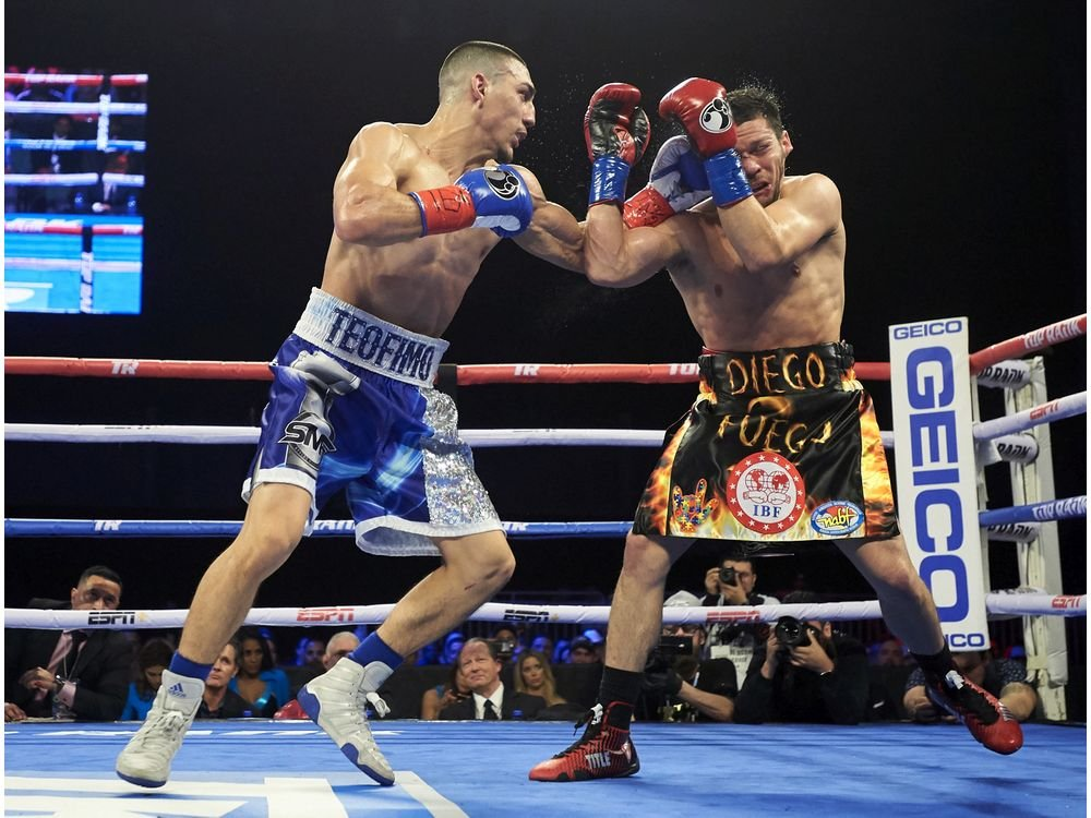 Teofimo Lopez (left) vs. Diego Magdaleno. Photo credit: AP Photo/Cooper Neill