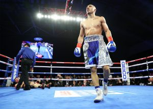 Teofimo Lopez (foreground). Photo credit: Mikey Williams/Top Rank