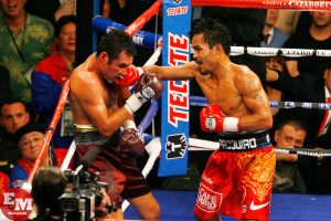 Oscar De La Hoya (left) vs. Manny Pacquiao. Photo credit: Ed Mulholland/HBO Boxing