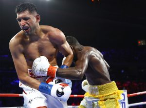 Amir Khan pain 300x221 - Terence Crawford punishes Amir Khan, but fight ends on disappointing low blow TKO