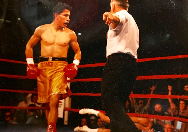 Danny Romero (standing) vs. Harold Grey. Photo courtesy of Danny Romero's Hideout